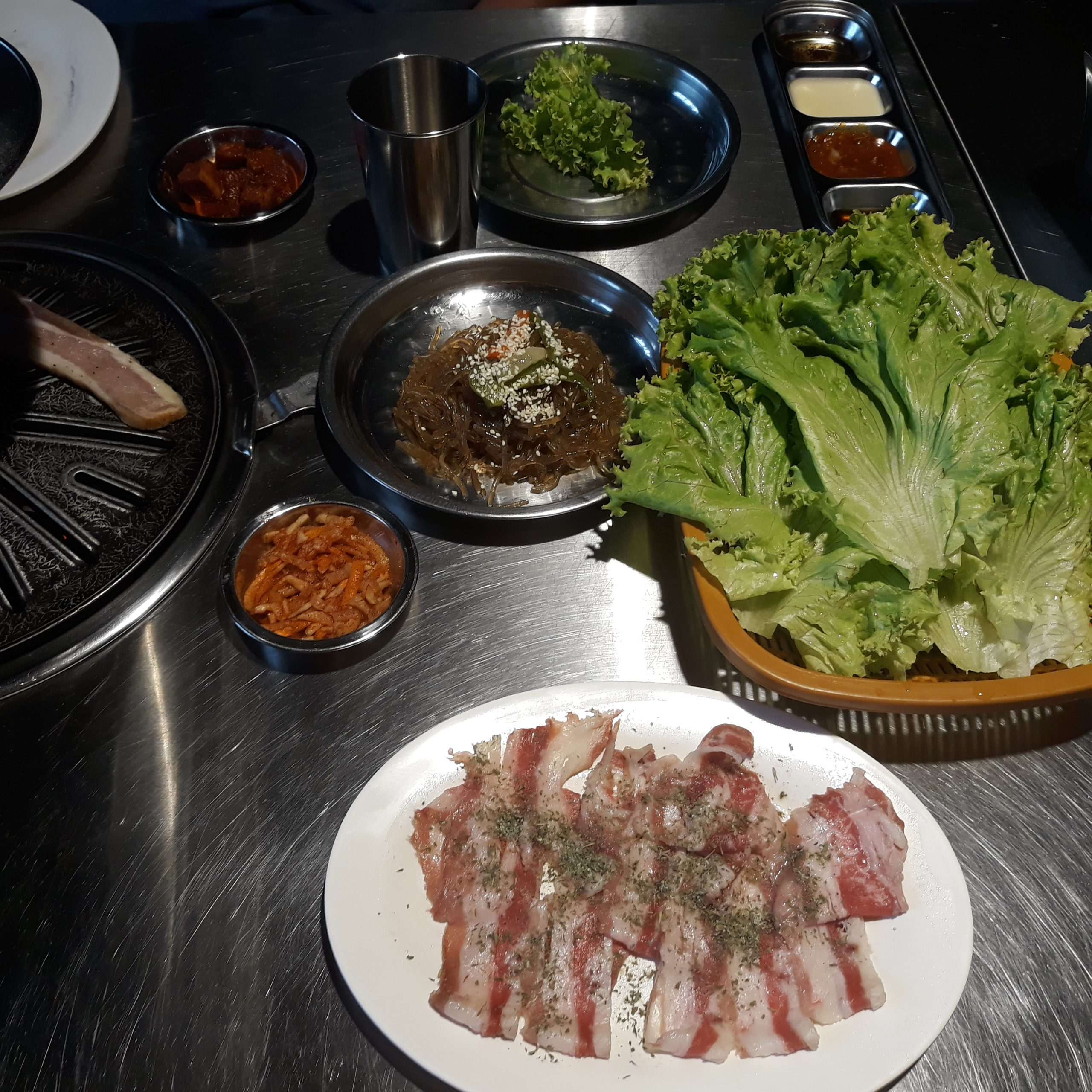 Seoulgyupsal's Herbed Dae Pae with some lettuce and Japchae on the side.
