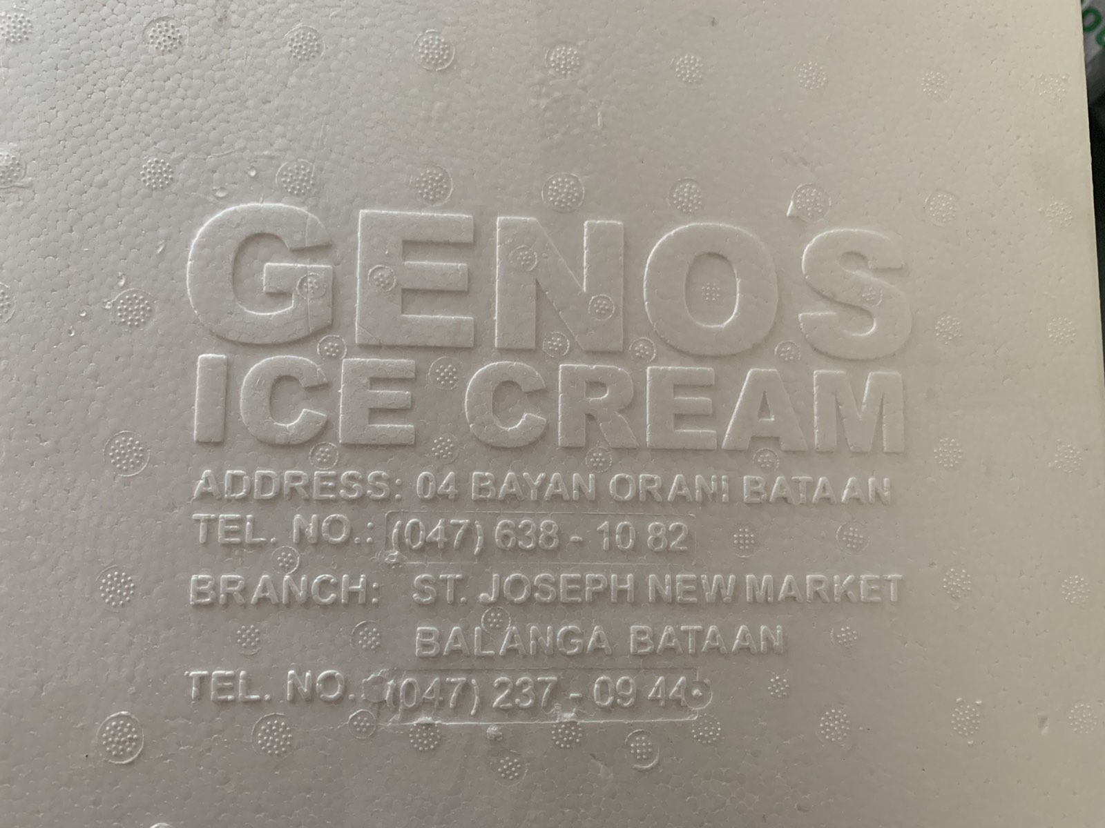 Geno's Ice Cream logo with address and telephone number.