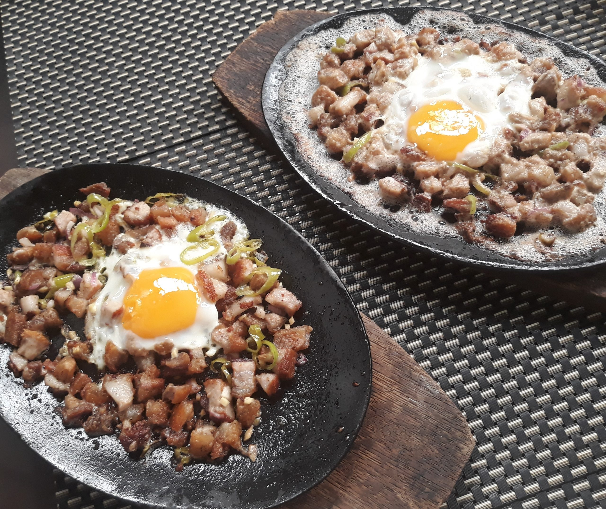 Sisig and dinakdakan dishes side by side.