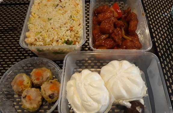 Yang chow fried rice, sweet & sour pork, siopao, and pork siomai from Hap Chan