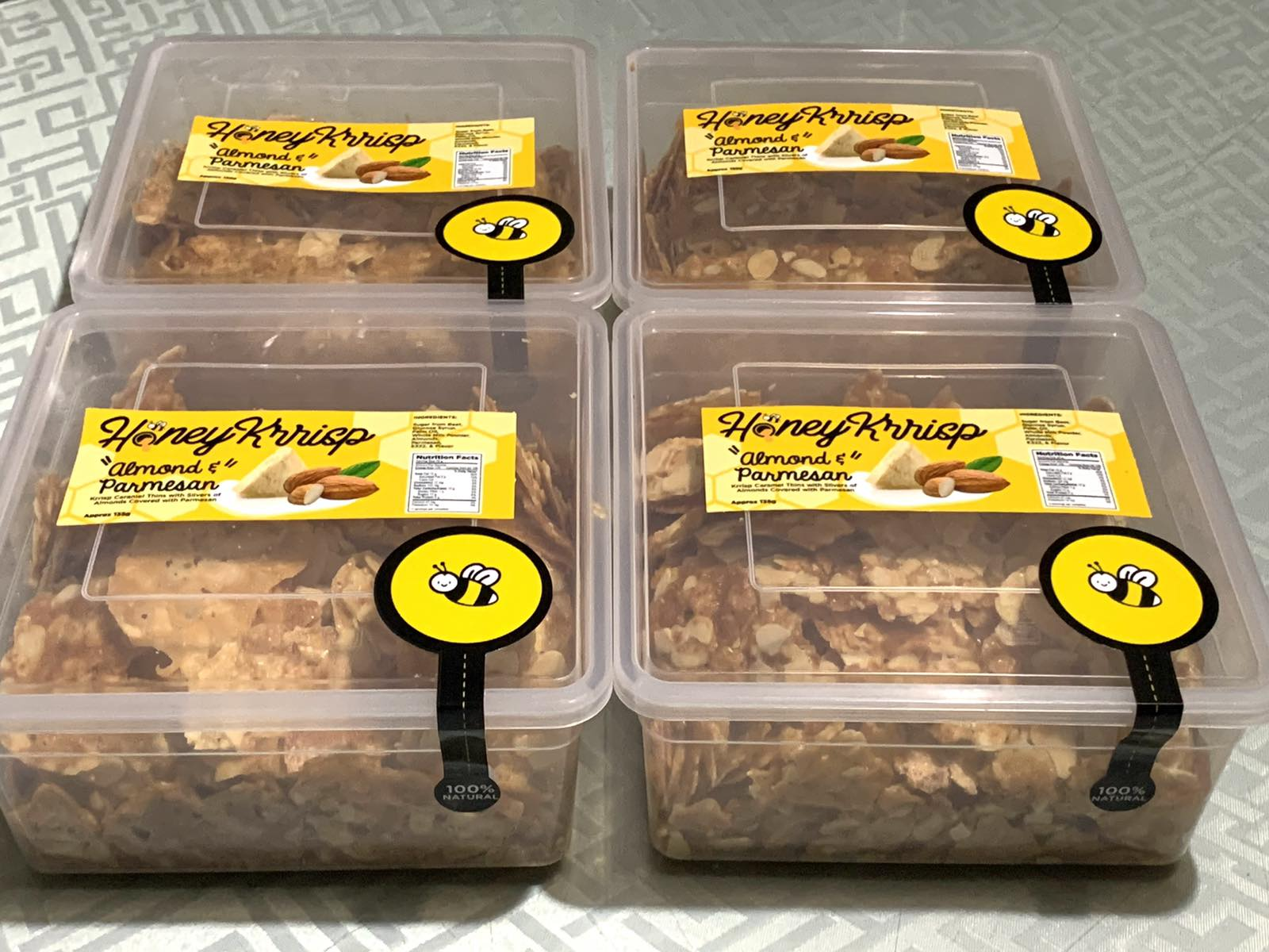 Four plastic containers of Honey Krrisp.