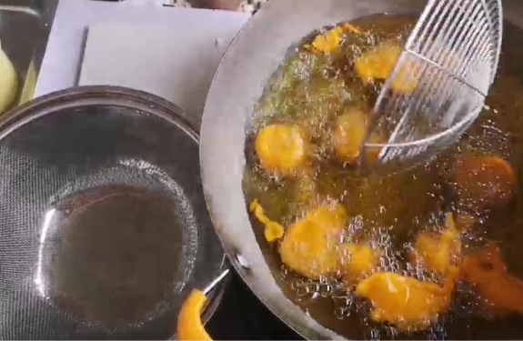 Deep frying kwek kwek