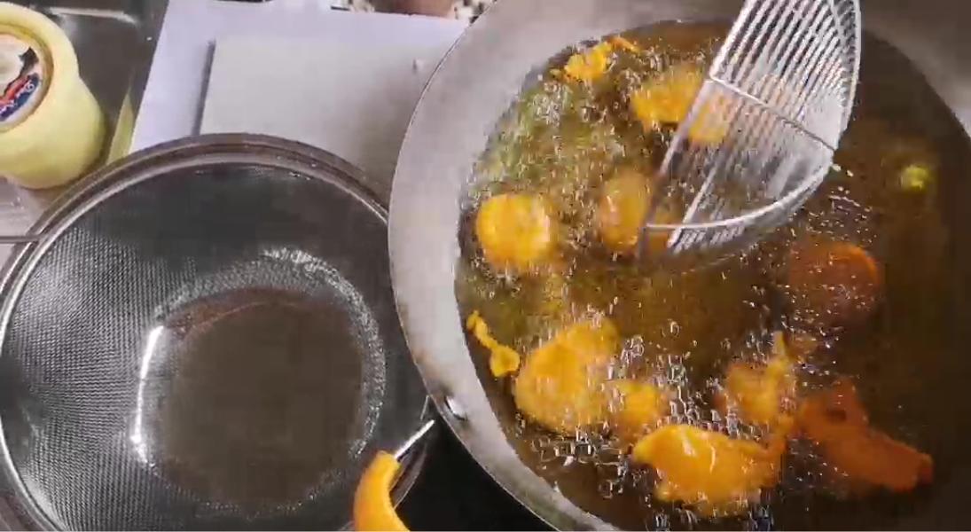 Pieces of kwek kwek being deep fried.