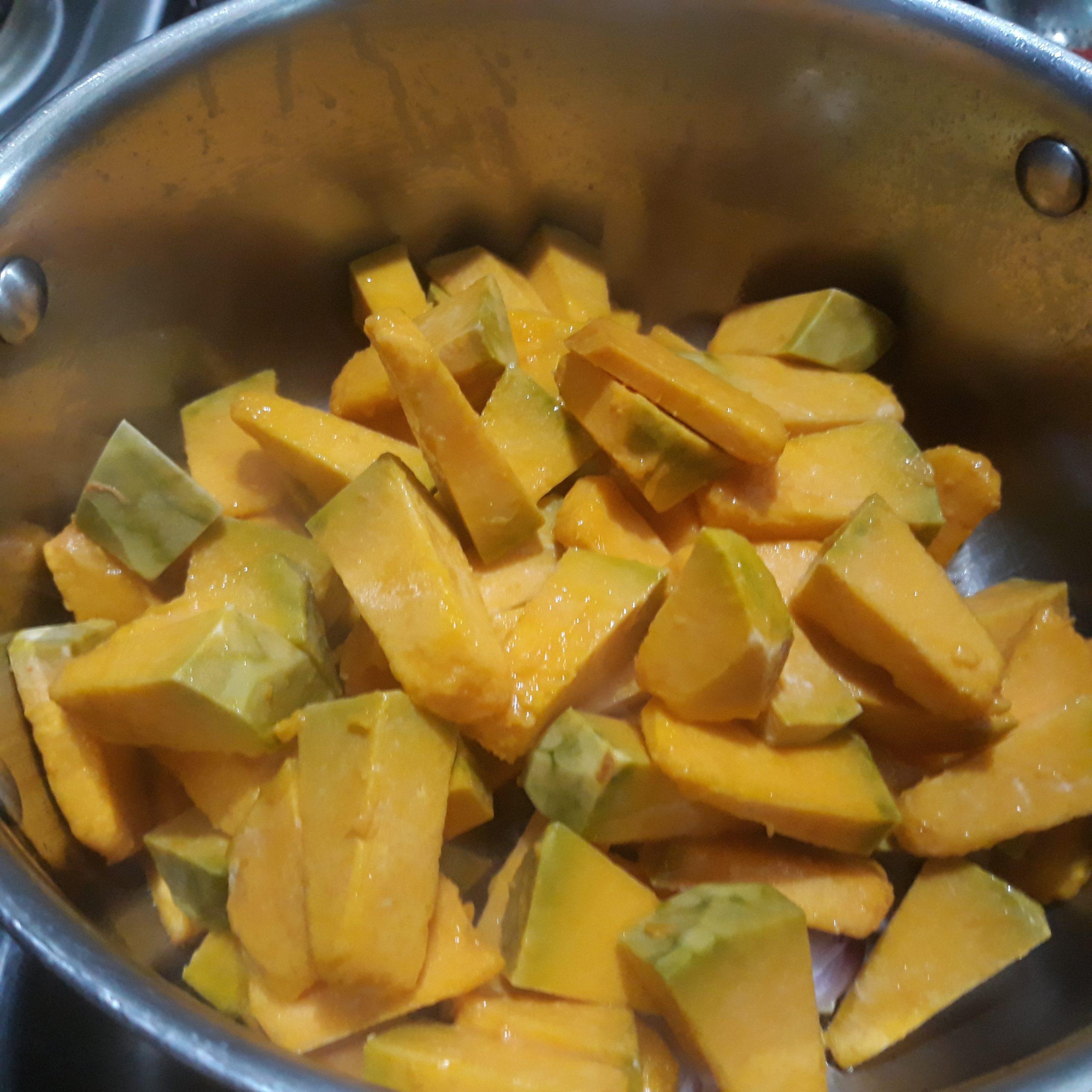 Pieces of kalabasa in a pan.
