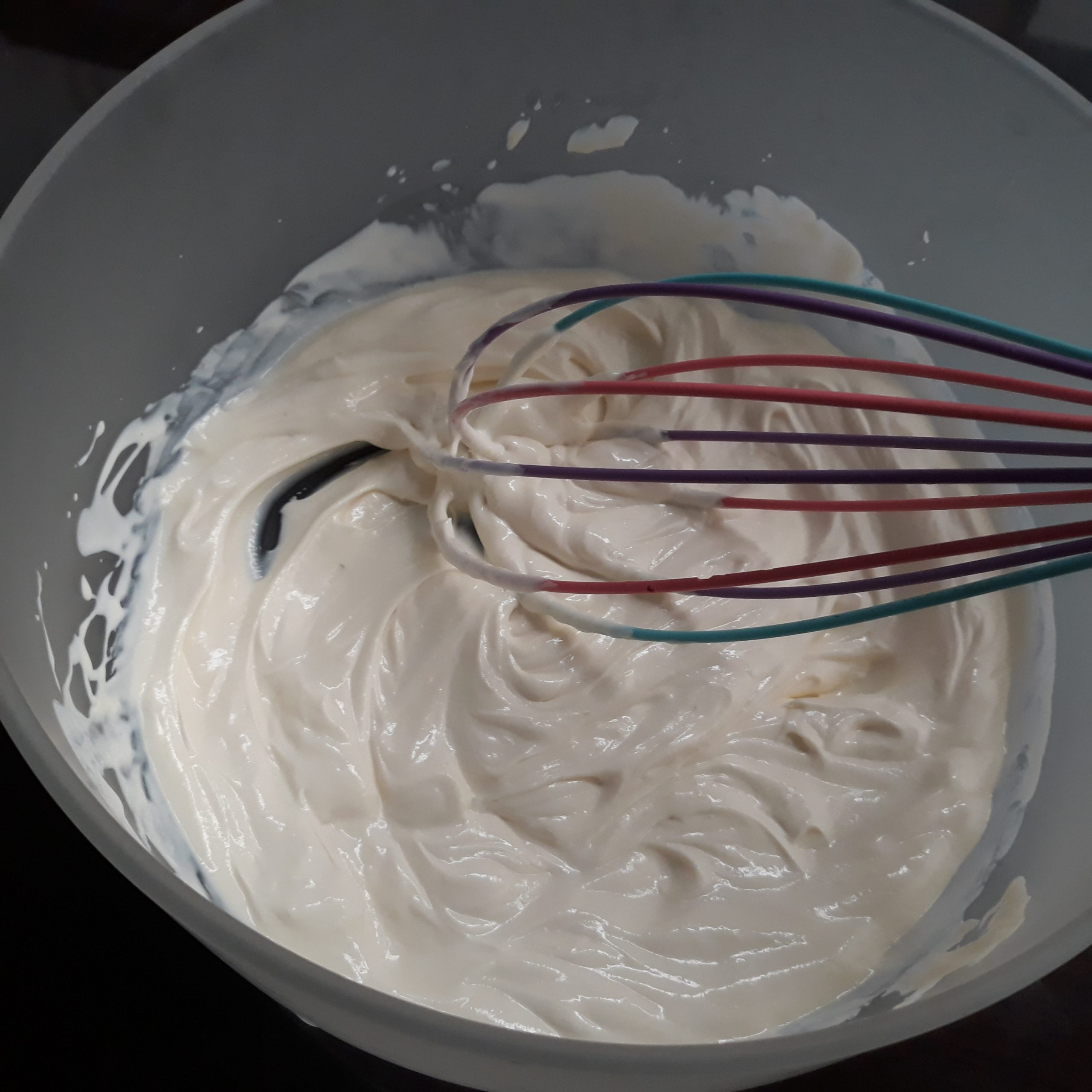 Whisking cream in a bowl.