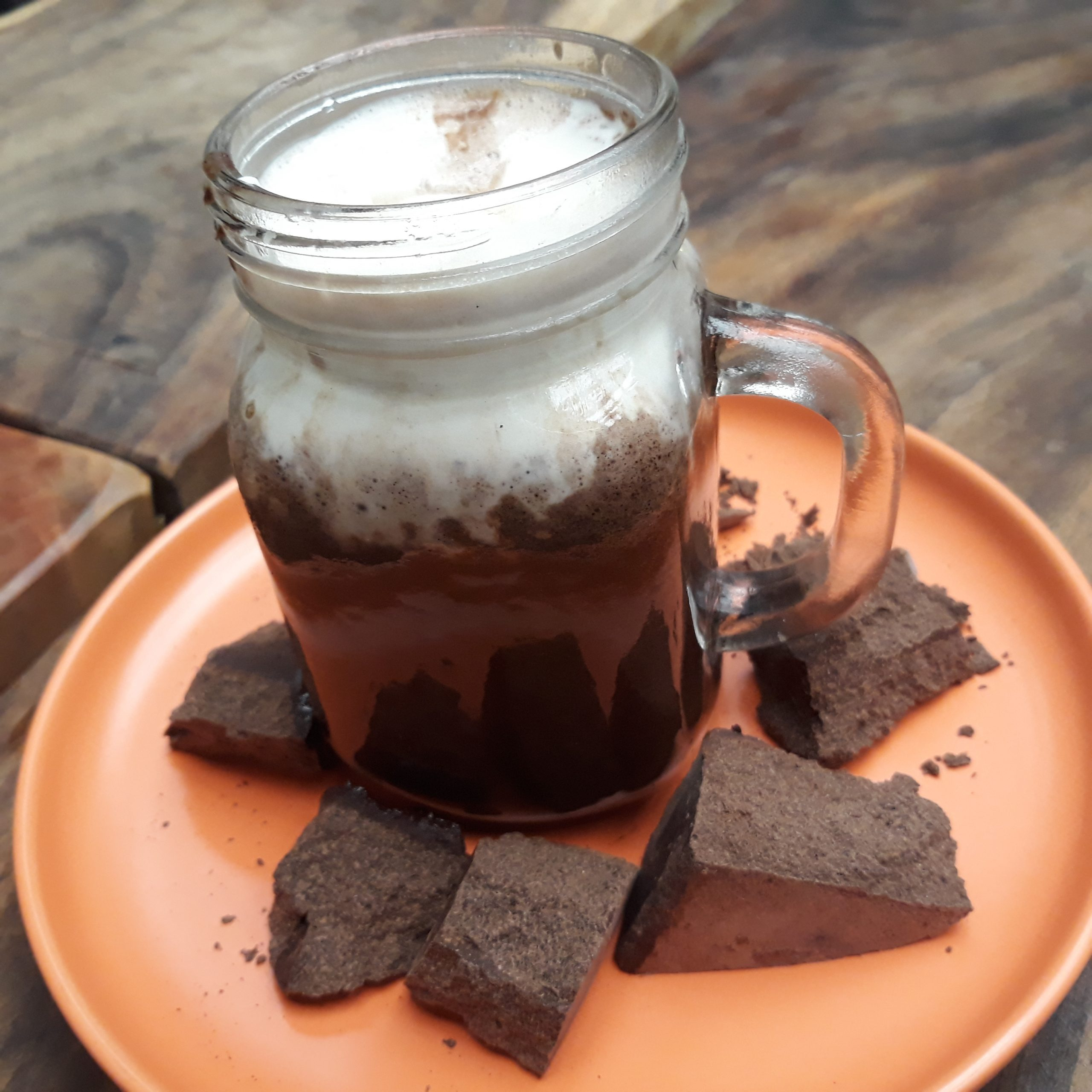 Hot chocoloate from tablea on an orange plate