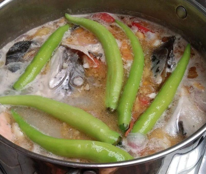 Sinigang na salmon sa miso topped with green chilis