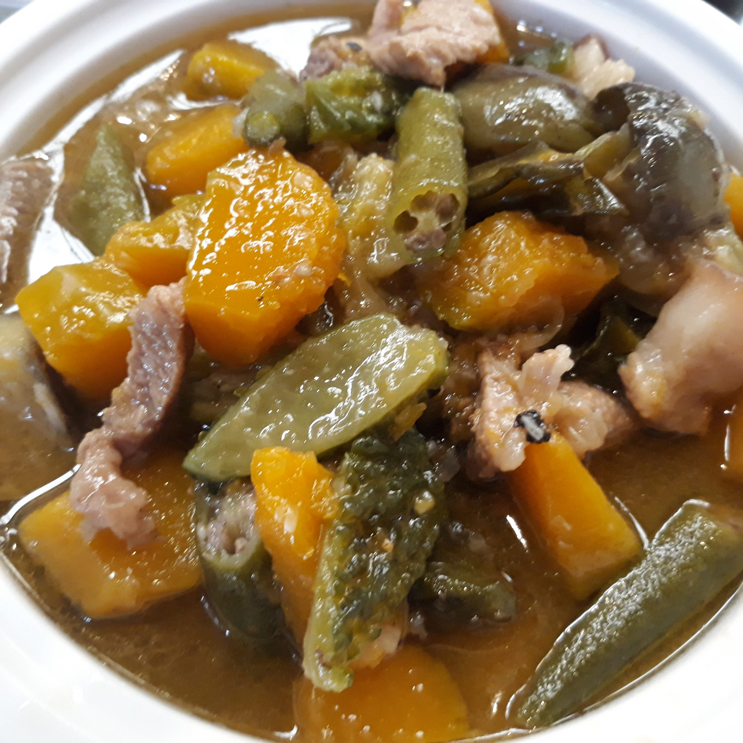 Pinakbet showing pieces of kalabasa, okra, and pork.