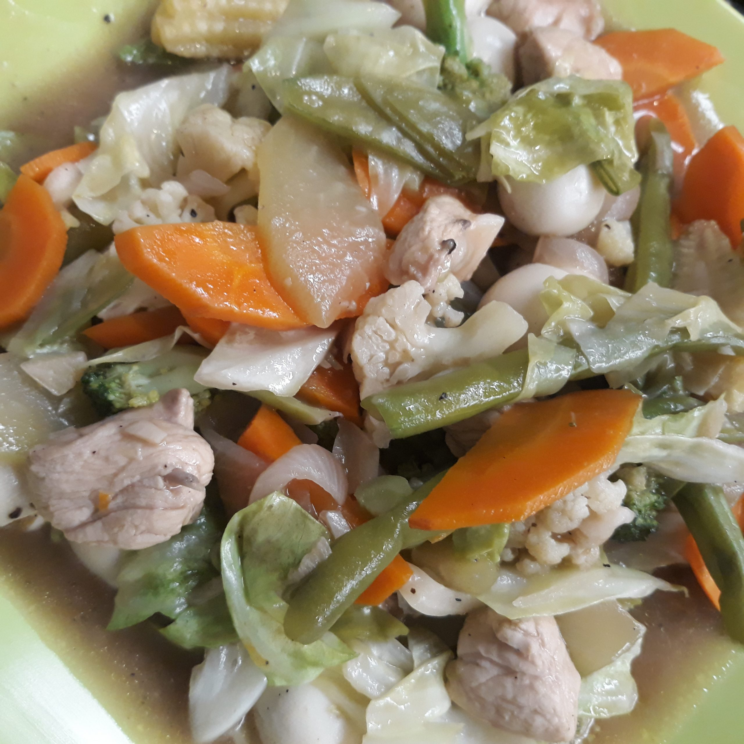 Chopsuey Dish showing bits of carrots, string beans, cauliflower.