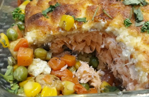 Baked salmon ala Contis in a serving dish.