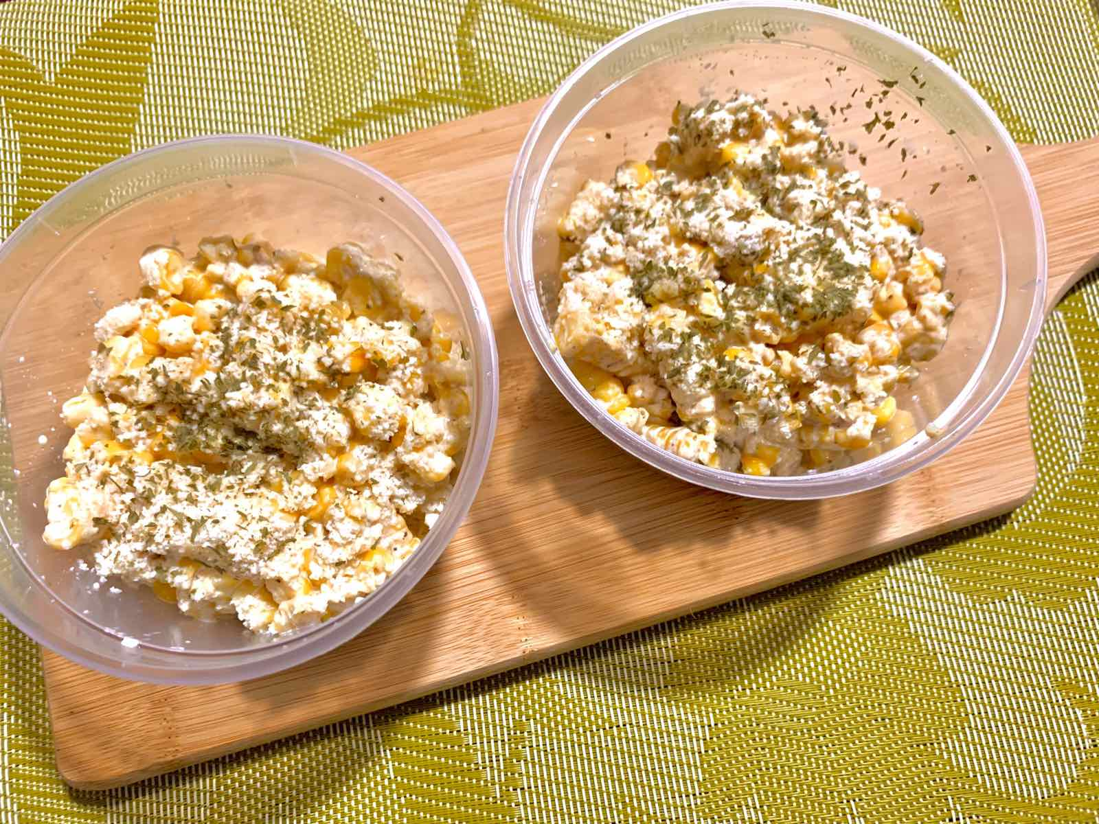 Mexican street corn in tubs.