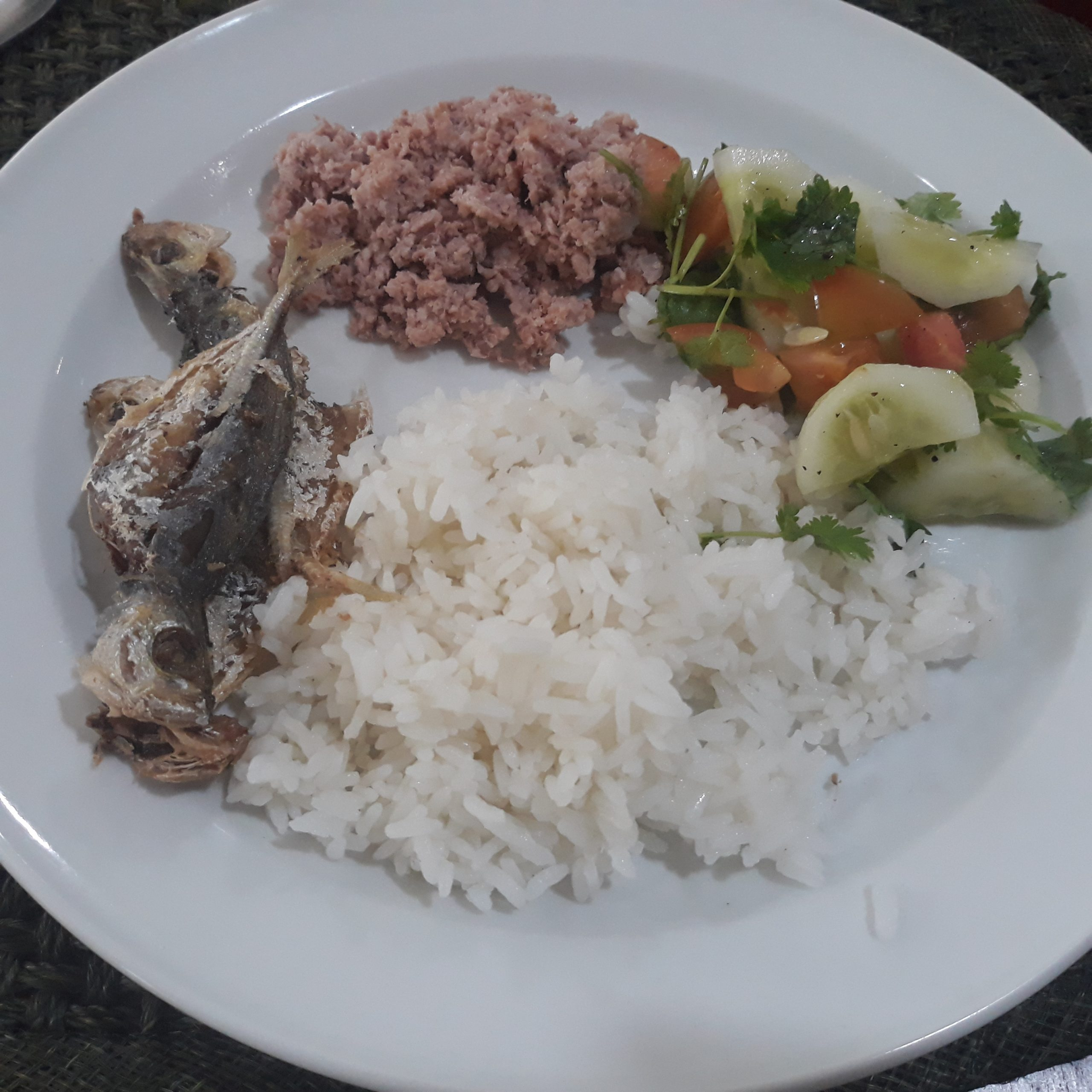 Sinantolan served with rice, fried fish, and veggies on the side.